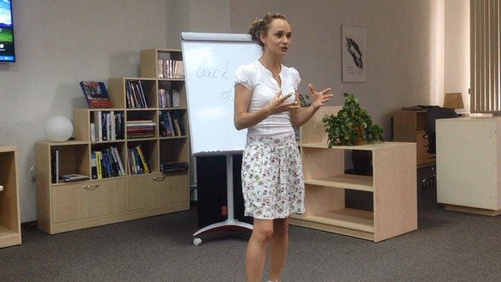 Alesya Teplyakova, a translator from Minsk, is giving her public speech in the libruary
